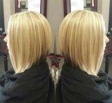 Ön Tarafı Uzun Arkası Kısa Platin Sarısı Orta Saç Modeli
